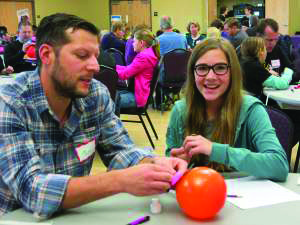 A father and daughter working on an engineering project at a previous parent-daughter engineering day. (Photo provided by the Engineering and Applied Technology College.)
